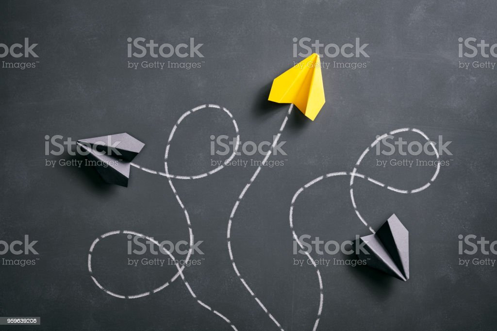 Paper airplane on blackboard - Origami Yellow Concept royalty-free stock photo
