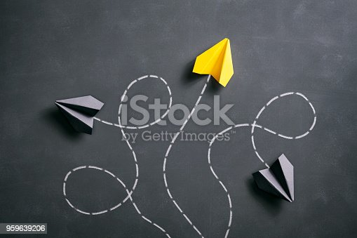 istock Paper airplane on blackboard - Origami Yellow Concept 959639206