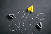Paper airplane on blackboard - Origami Yellow Concept