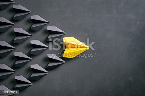istock Paper airplane on blackboard - Origami Yellow Concept 959639296