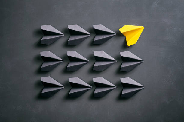 paper airplane on blackboard - origami yellow concept - dotted line stock photos and pictures