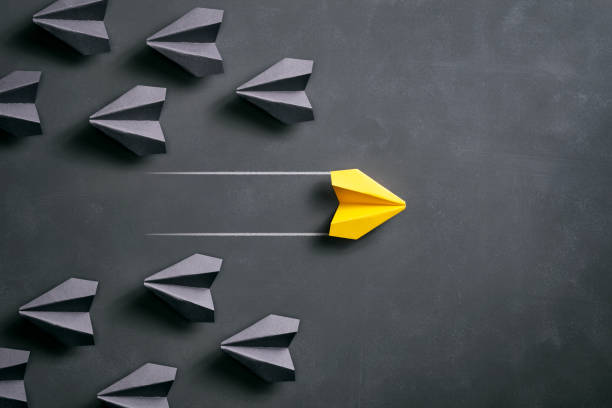 paper airplane on blackboard - origami yellow concept - paper airplane stock photos and pictures