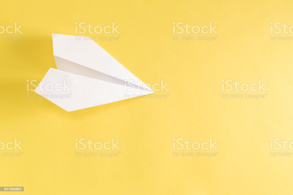 Paper airplane on yellow - foto stock