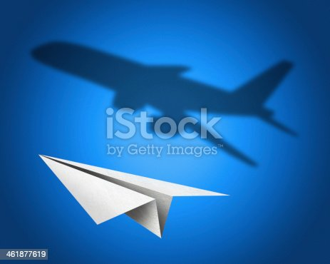istock Paper airplane with a shadow of jetliner 461877619