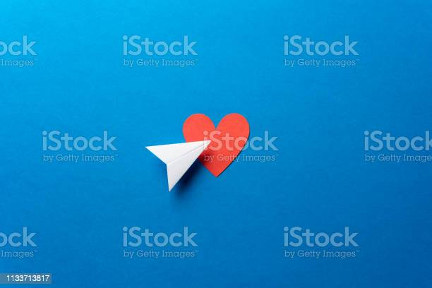 Paper airplane with red heart shape on blue background sharing and picture id1133713817?b=1&k=6&m=1133713817&s=612x612&h=vrjuamypqtzs6tmuhxow8sln1a1blpxudsxk4 4jnpg=