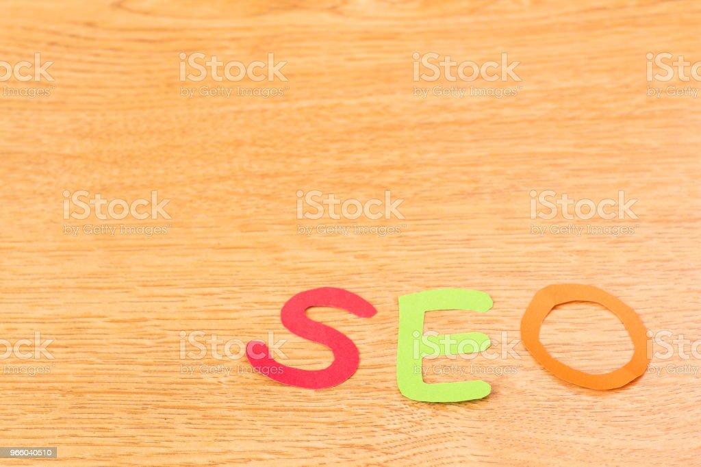 Alfabet SEO op hout achtergrond papier - Royalty-free Alfabet Stockfoto