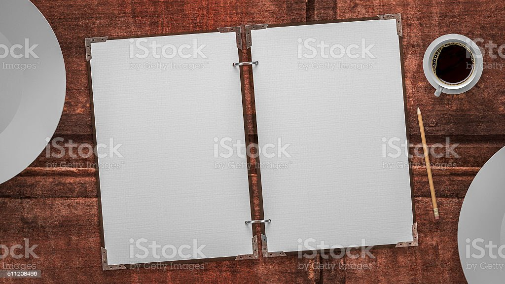 paper and plates on a old wooden table stock photo