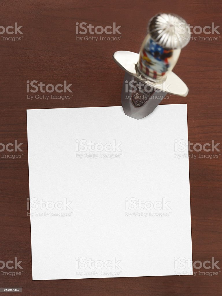 Paper background and a dagger royalty-free stock photo
