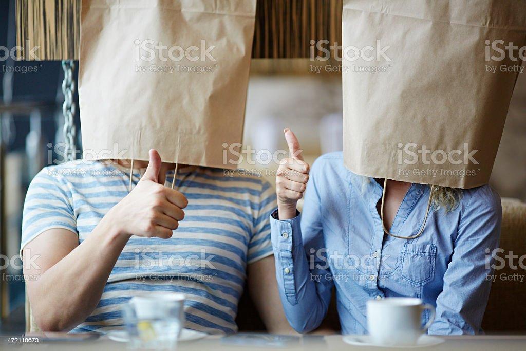 Paper bag couple stock photo