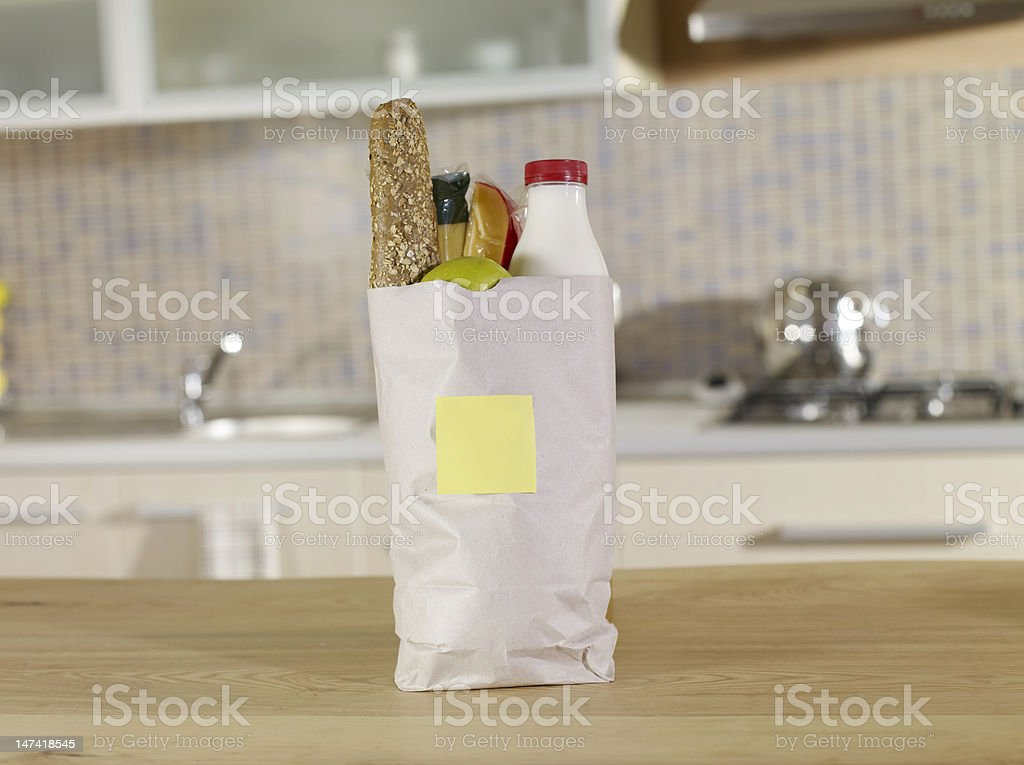 Paper bag filled with dairy products royalty-free stock photo