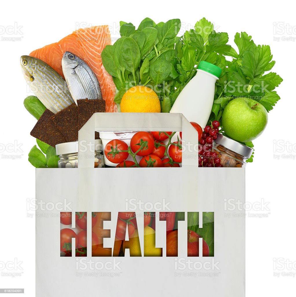Paper bag full of healthy foods isolated on white stock photo
