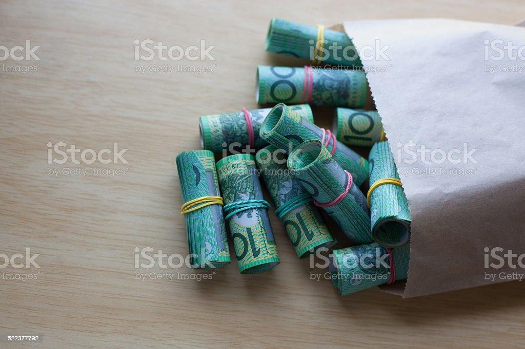 Paper bag full of money stock photo