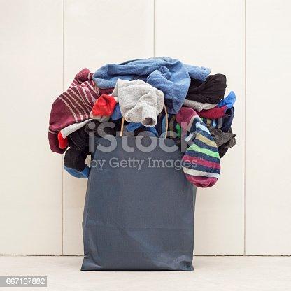istock paper bag full of socks 667107882