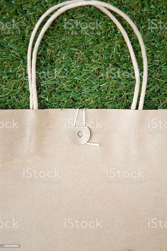 paper bag on grass royalty-free stock photo