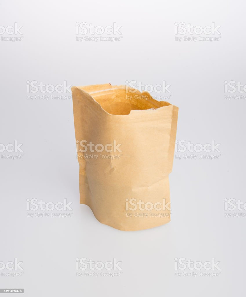paper bag or kraft paper stand up pouch on a background stock photo