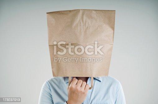 woman wearing a paper bag