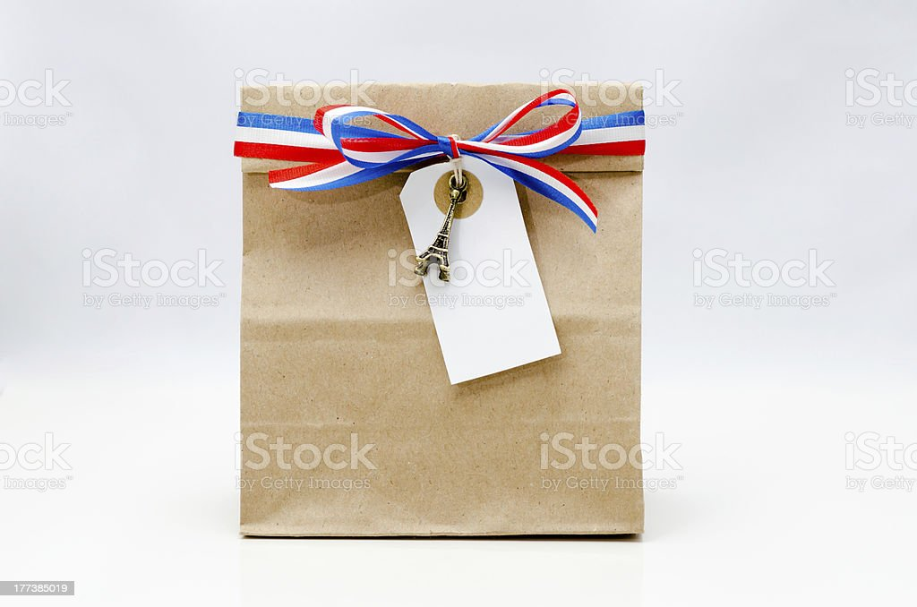 Paper bag with bow and ribbon royalty-free stock photo