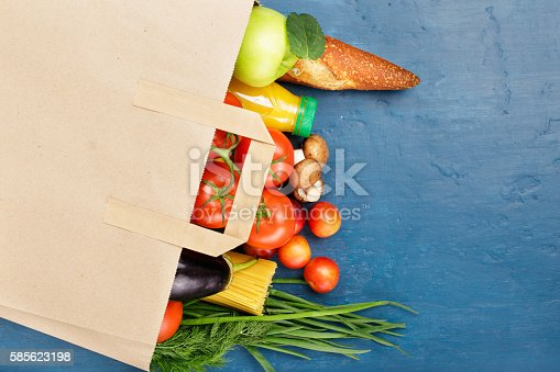 istock Paper bag with different of vegetables and fruits 585623198