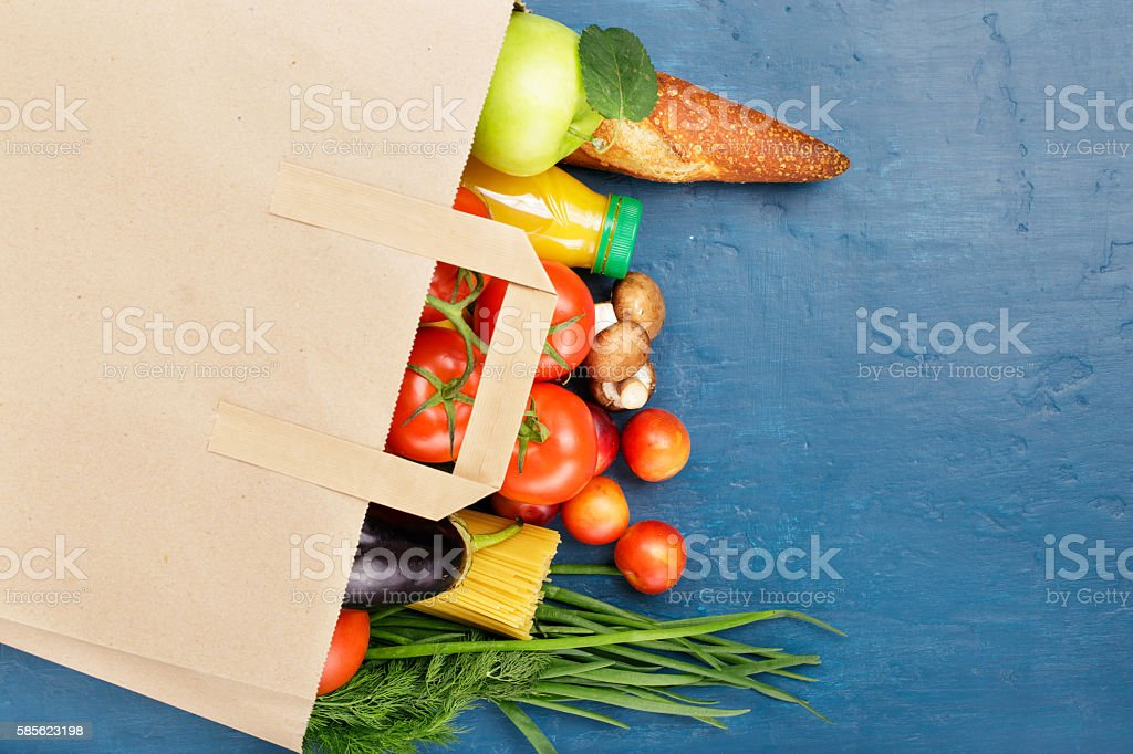 Paper bag with different of vegetables and fruits stock photo