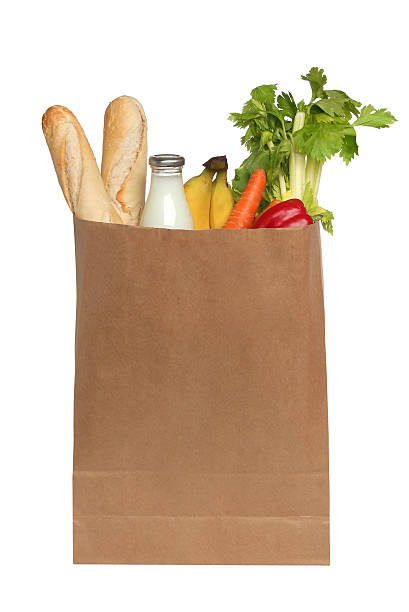 paper bag with food on a white background stock photo