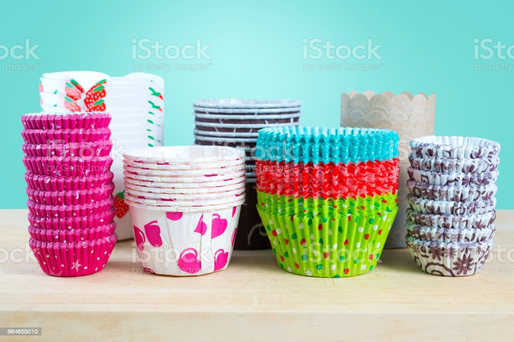 Paper baking case for cupcake and muffin ,tiffany blue background. royalty-free stock photo