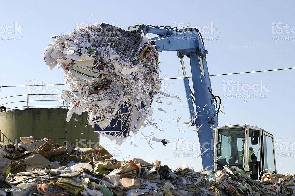 Paper being recycled at waste collection plant royalty-free stock photo