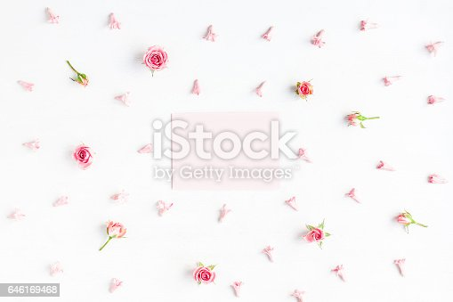 istock Paper blank and pink flowers on white background 646169468