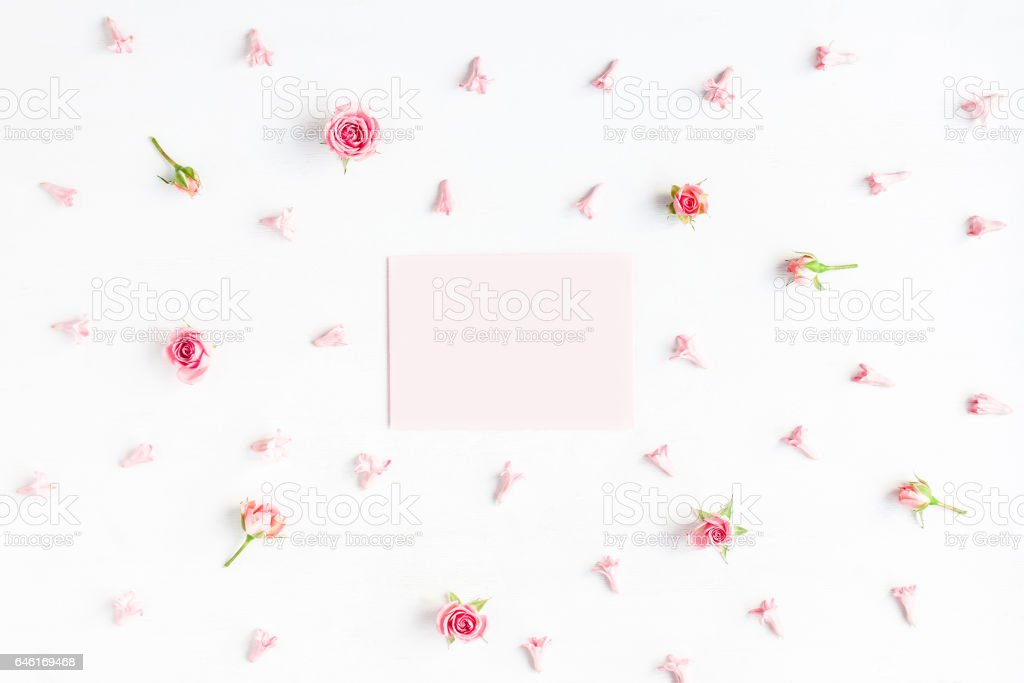 Paper blank and pink flowers on white background stock photo