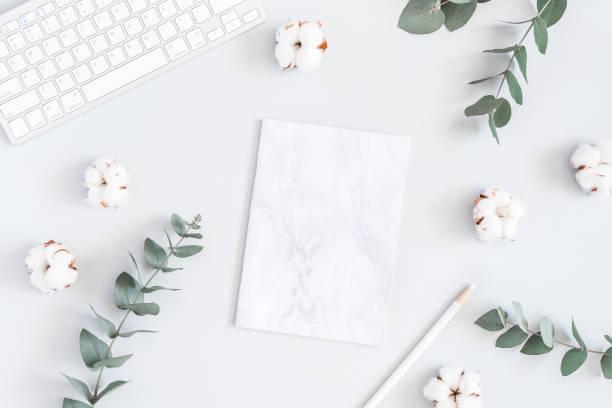 paper blank, cotton flowers, eucalyptus branches. flat lay, top view - folha de caderno imagens e fotografias de stock