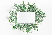 istock Paper blank, thuja branches on white background. Flat lay 873339180