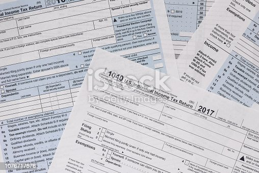 184625018 istock photo Paper blanks of 1040 tax form close up 1076717576