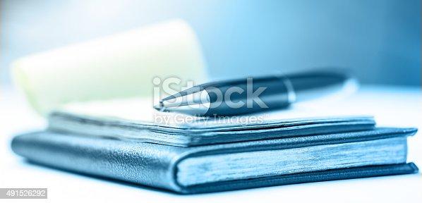 istock Paper blocks with pen 491526292