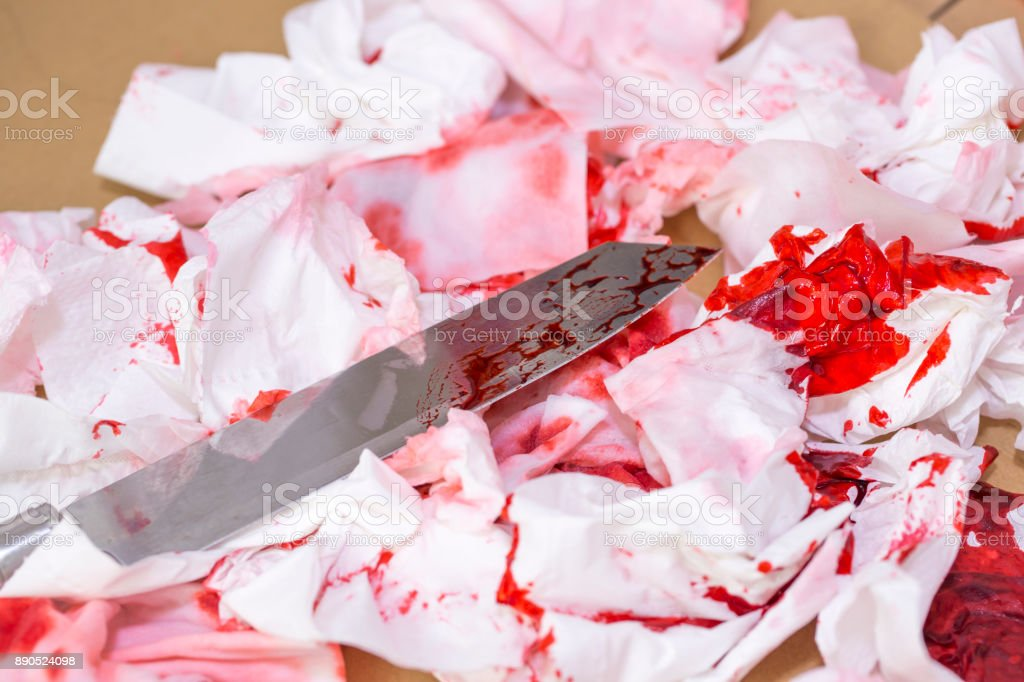 Paper bloody and one knife. stock photo
