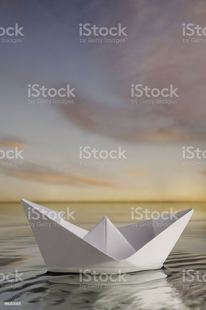 Paper boat in calm water royalty-free stock photo