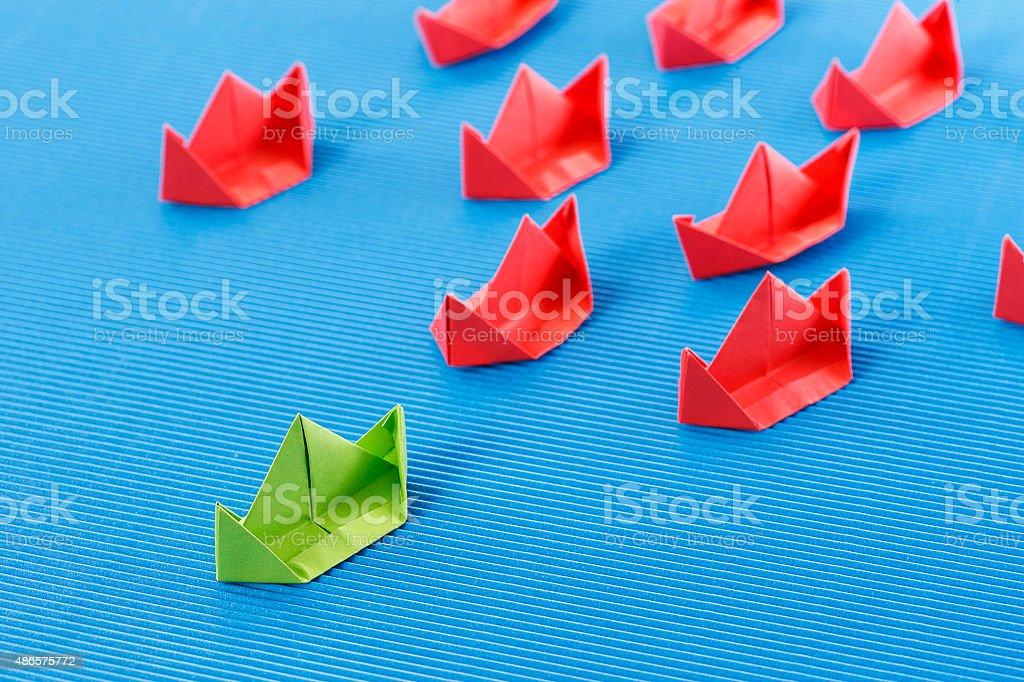 Paper boat in ocean. Blue ocean marketing concept.