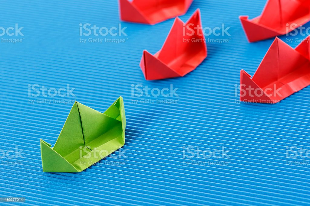 Paper boat in ocean. Blue ocean marketing concept. stock photo