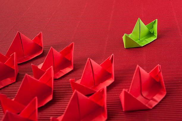 Paper boat in ocean. Red ocean marketing concept. stock photo