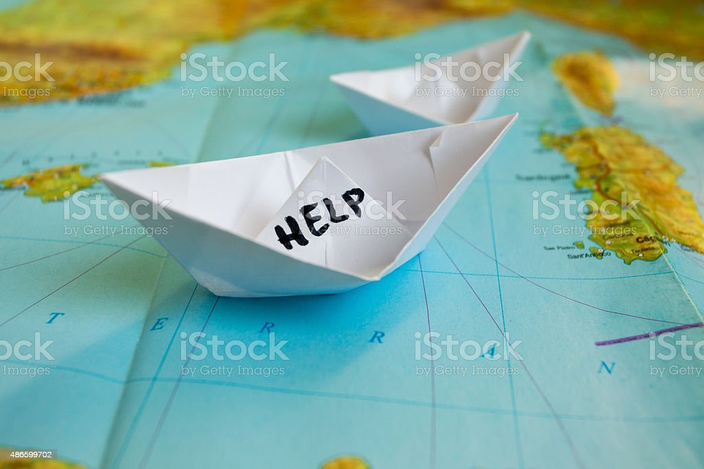 Paper Boat Map Help Refugees stock photo