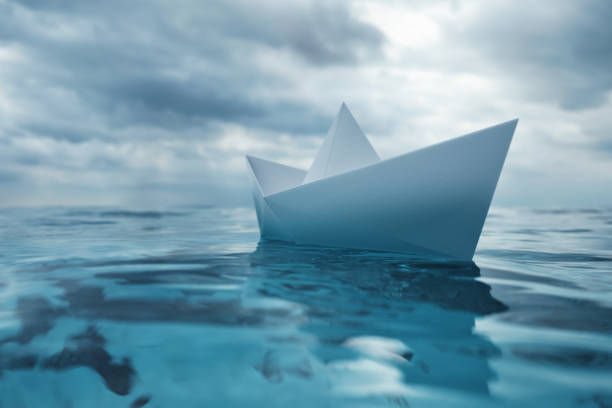 Paper Boat on Sea stock photo