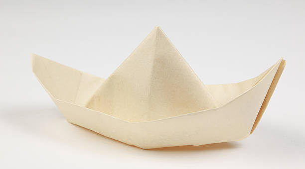Paper boat on white stock photo