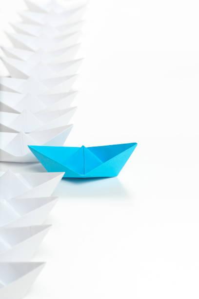 paper boat race stock photo