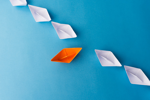 Paper Boats on Blue Background
