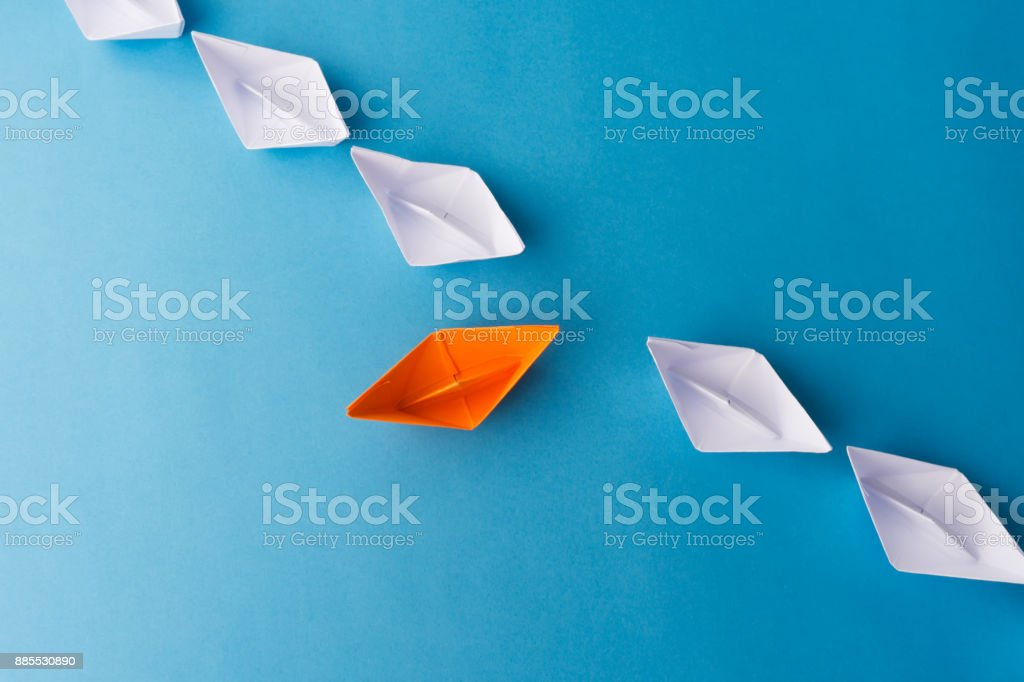 Paper Boats on Blue Background stock photo