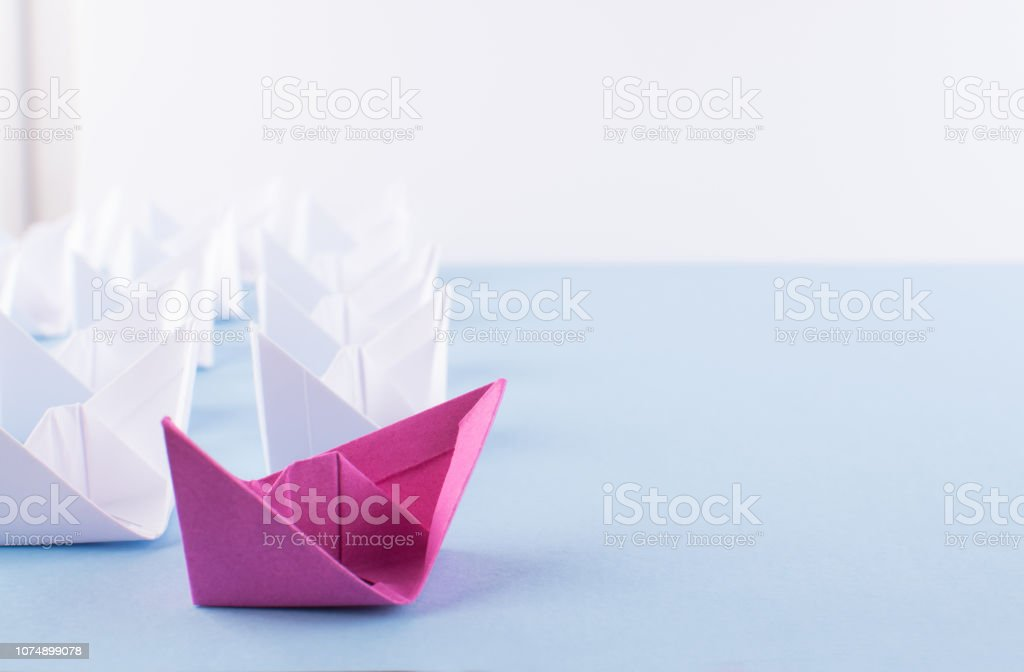 One Unique Pink Paper Boat among Many Ones. Different Paper Ships as...