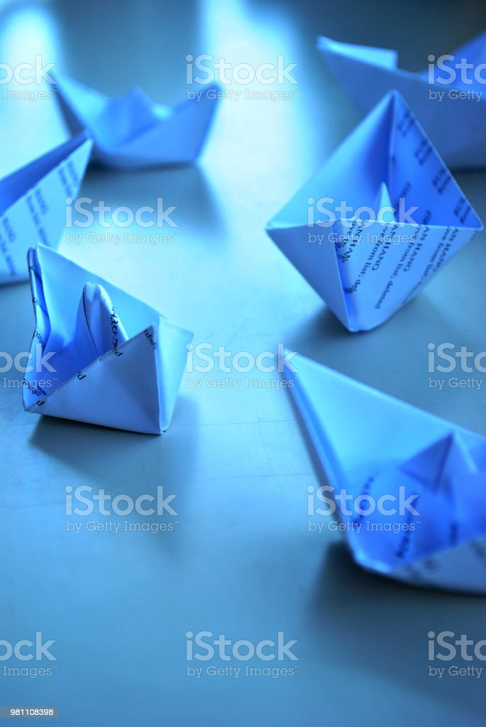 paper boats on the table