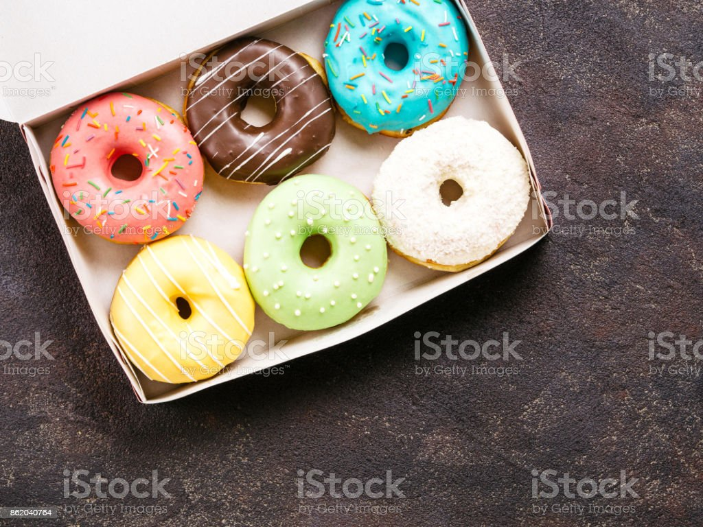 paper box with colorful donuts, top view, copy space stock photo