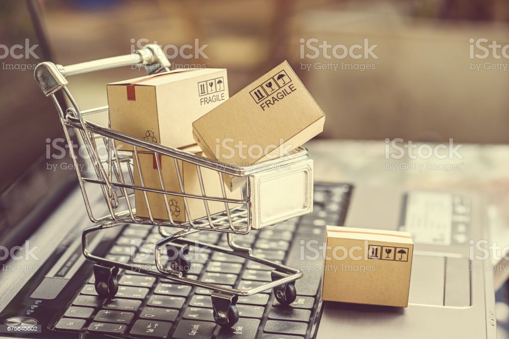 Paper boxes in a shopping cart. royalty-free stock photo