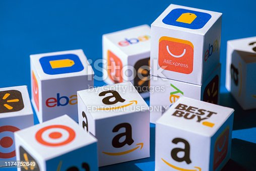 Kyiv, Ukraine - September 10, 2019: A paper cubes collection with printed logos of eCommerce corporations and online retail stores, such as AliExpress, WallMart, eBay, Amazon, and others.