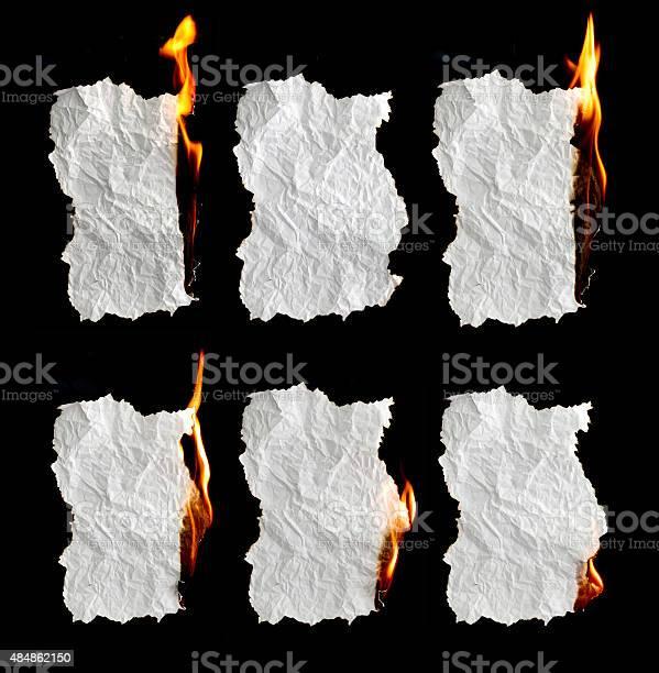 Photo of paper burning on black background