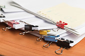 istock Paper business documents with color clips 1144279197